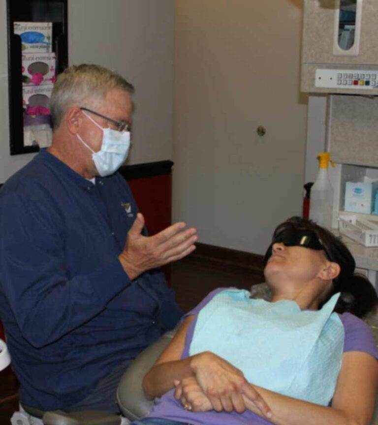 Dr. Kitzmiller talks to patient about treatment in Apex, NC
