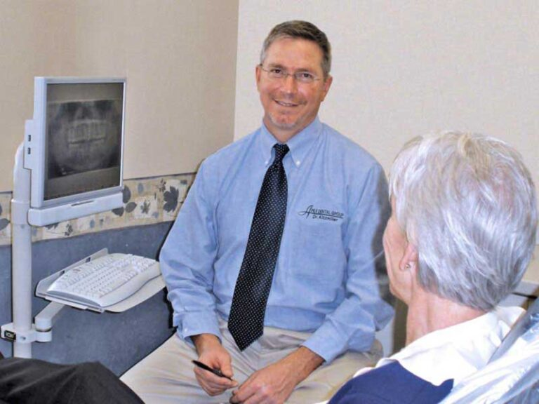 Dr. Kitzmiller with patient, chair-side monitor