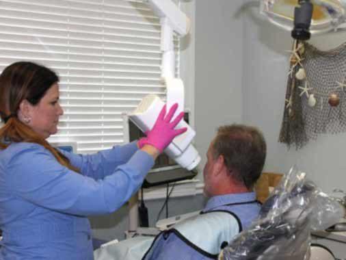 Dental Hygienist takes Bitewing Xray