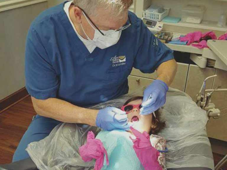 Dr. Kitzmiller with pediatric patient in Apex, NC